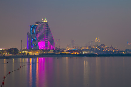 DUBAI, UAE - MARCH 30, 2017: The evening skyline with the Jumeirah Beach Hotel. Editorial