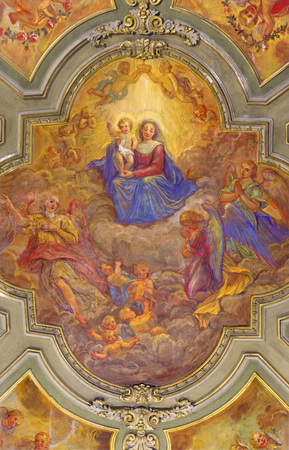 TURIN, ITALY - MARCH 14, 2017: The ceiling fresco of Madonna among the angels in church Chiesa di San Francesco Giovanni Andrea Casella (1619 - 1856). Stock Photo