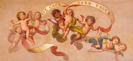 TURIN, ITALY - MARCH 13, 2017: The neo baroque fresco of angels with the inscription in church Chiesa di San Giuseppe by Giuseppe Ferrari d Orsara (1909).