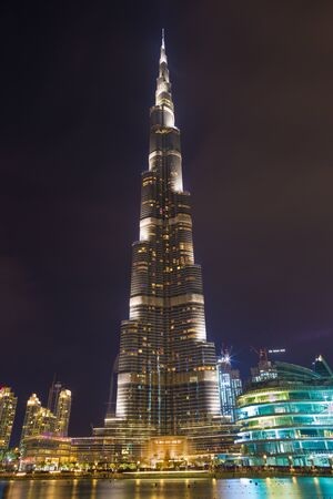 DUBAI, UAE - MARCH 24, 2017: The nightly Burj Khalifa and the fountain.