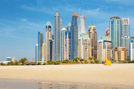 DUBAI, UAE - MARCH 28, 2017: The Marina towers from beach. Editorial