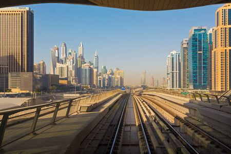 DUBAI, UAE - APRIL 1, 2017: The Marina towers and the rails of metro.