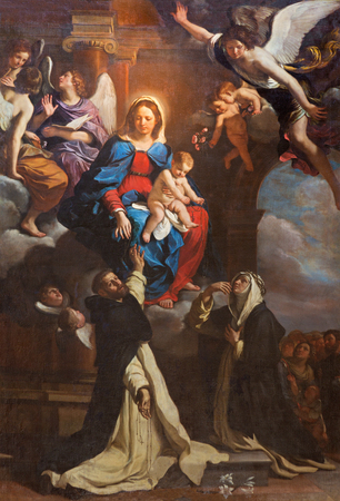 saint: TURIN, ITALY - MARCH 14, 2017: The Painting of Madonna with the St. Dominic and St. Catherine in church Chiesa di San Domenicoby Giovanni Francesco Barbieri (1635). Editorial