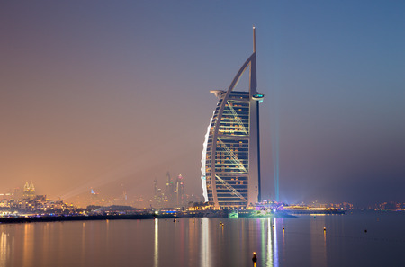 DUBAI, UAE - MARCH 30, 2017: The evening skyline with the Burj al Arab and Marina towers in the background.