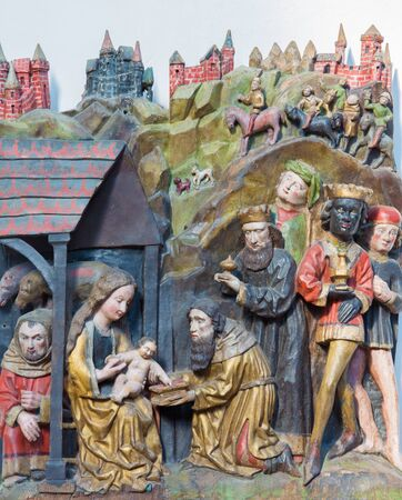 BERLIN, GERMANY, FEBRUARY - 16, 2017: The carved polychrome relief of Three Magi in church Marienkirche by unknown artist. Editorial
