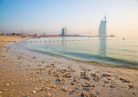 DUBAI, UAE - MARCH 30, 2017: The evening skyline with the Burj al Arab and Jumeirah Beach Hotels and the open Jumeriah beach. Editorial