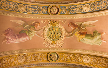 TURIN, ITALY - MARCH 15, 2017: The detail of fresco of angels with initials of Virgin Mary on the ceiling in church Basilica Maria Ausiliatrice by unknown artist of 19. cent..