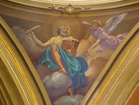 TURIN, ITALY - MARCH 13, 2017: The fresco of St. Matthew the Evangelist in cupola of Church Chiesa di Santo Tommaso by C. Secchi from bechin of 20. cent.