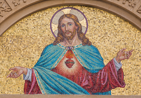 TURIN, ITALY - MARCH 15, 2017: The mosaic of Heart of Jesus on the facade of  Chiesa del Sacro Cuore di Gesu on the square Piazza Maria Ausiliatrice by unknown artist from end of 19. cent.