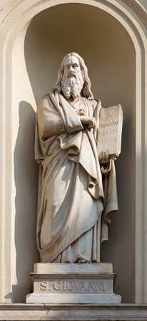 TURIN, ITALY - MARCH 16, 2017: The marble statue of St. John the Evangelist on the facade of church Chiesa di San Massimo from 19. cent.