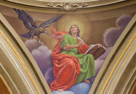 new testament: TURIN, ITALY - MARCH 13, 2017: The fresco of St. John the Evangelist in cupola of Church Chiesa di Santo Tommaso by C. Secchi from bechin of 20. cent. Editorial