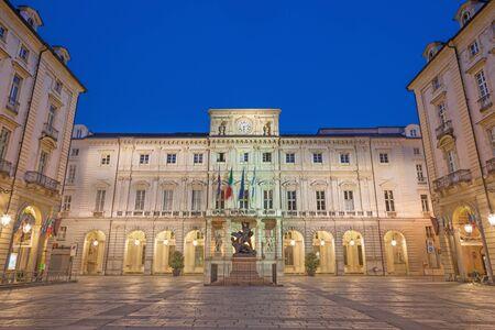 Turin - The square Piazza di Citta with the Palazzo Civico and Monumento al Conte Verde at dusk. Archivio Fotografico