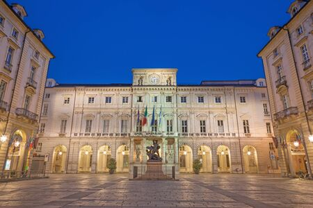 Turin - The square Piazza di Citta with the Palazzo Civico and Monumento al Conte Verde at dusk. 版權商用圖片