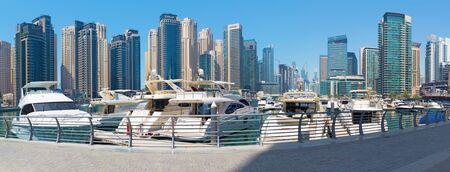 DUBAI, UAE - APRIL 1, 2017: The Marina promenade and the yachts.