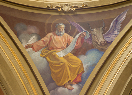 TURIN, ITALY - MARCH 13, 2017: The fresco of St. Luke the Evangelist in cupola of Church Chiesa di Santo Tommaso by C. Secchi from bechin of 20. cent.