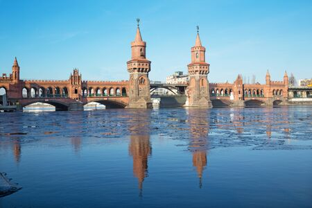 Berlin - The Oberbaum bridge and the block of ice on the Spree river.