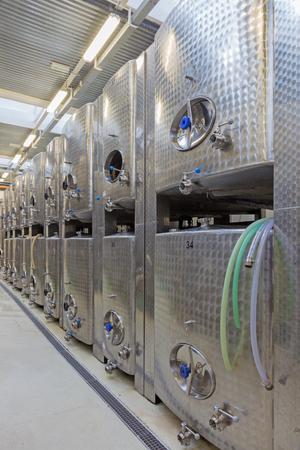 BRATISLAVA, SLOVAKIA - JANUARY 30, 2014: Indoor of wine manufacturer great Slovak producer. Modern big cask for the fermentation.
