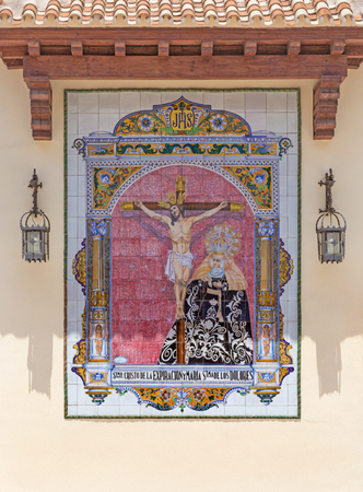 MALAGA, SPAIN - MAY 25, 2015: The ceramic tiled, cried Madonna under the Crucifixion on the facade of church Parroquia de San Pedro (St. Peters church) by Ceramica Antonio Vadillo Plata (20 cent.).