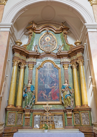 TRNAVA, SLOVAKIA - MARCH 3, 2014: The side baroque altar in Jesuits church from 18. cent.