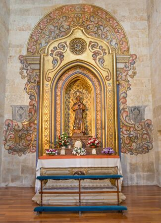 SALAMANCA, SPAIN, APRIL - 16, 2016: The baroque polychrome side altar of St. Martin de Porres in church  Convento de San Esteban by unknown artist.