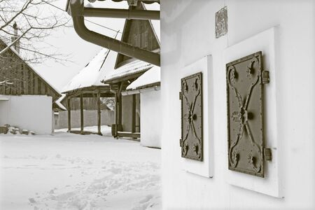 shutter: Sebechleby - The shutters of old vine cellar houses from middle Slovakia (Stara Hora) in winter. Stock Photo