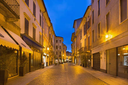 CREMONA, ITALY - MAY 24, 2016: The street of old town in morning dusk. Editorial