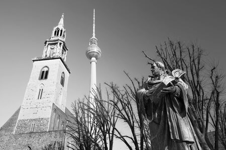 BERLIN, GERMANY, FEBRUARY - 13, 2017: The staue of reformator Martin Luther in front of Marienkirche church by Paul Martin Otto and Robert Toberenth (1895).