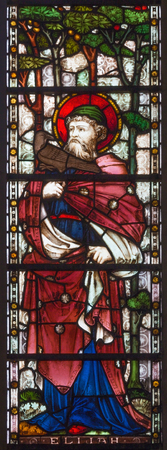 LONDON, GREAT BRITAIN - SEPTEMBER 19, 2017: The prophet Elijah on the stained glass in St Mary Abbot's church on Kensington High Street.