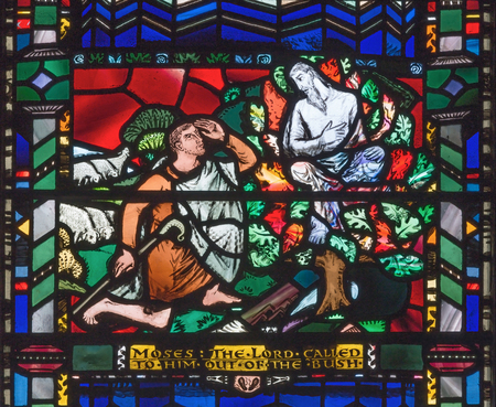 LONDON, GREAT BRITAIN - SEPTEMBER 16, 2017: The stained glass of Moses and the Burning Bush in church St Etheldreda by Charles Blakeman (1953 - 1953).