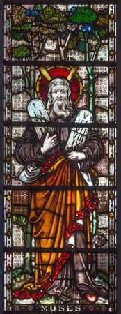 LONDON, GREAT BRITAIN - SEPTEMBER 19, 2017: The patriarch Moses on the stained glass in St Mary Abbots church on Kensington High Street.