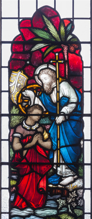 LONDON, GREAT BRITAIN - SEPTEMBER 19, 2017: The St. Philip baptism of the Ethipian Eunuch on Stained glass in St Mary Abbots church on Kensington High Street.