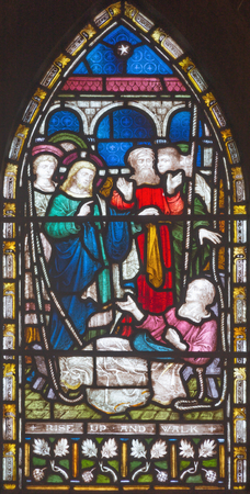 LONDON, GREAT BRITAIN - SEPTEMBER 19, 2017: The Jesus Heals lame man on the stained glass in St Mary Abbot's church on Kensington High Street. Sajtókép