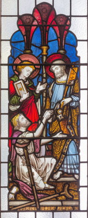 LONDON, GREAT BRITAIN - SEPTEMBER 19, 2017: The apostles Peter and John heal of paralytic in front of Temple in Jerusalem on the stained glass in St Mary Abbots church on Kensington High Street.