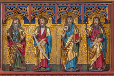 BERLIN, GERMANY, FEBRUARY - 16, 2017: The carved statue of apostles Andrew, Simon, Jude Thaddheus and James the Great in church of St. Pauls by unknown artist (1915).