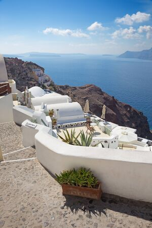 Santorini - The Oia and Therasia island in the background.