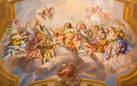 VIENNA, AUSTRIA - JULY 30, 2014: The symbolic fresco of woman wiht the angels and music instruments in baroque church of St. Charles Borromeo by Johann Michael Rottmayr. Editorial