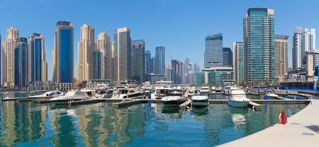Dubai - The promenade of Marina and the yachts. Editorial