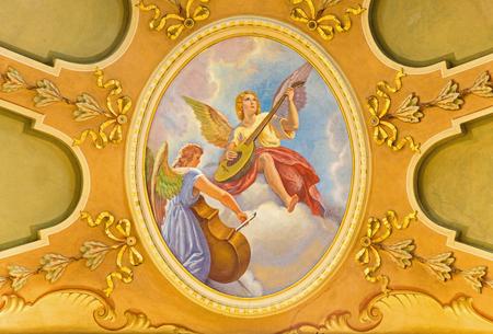 TURIN, ITALY - MARCH 13, 2017: The fresco of angels with the music instruments in  Church Chiesa di Santo Tomaso by Giovanni Battista Secchi (1876 - 1950). Editorial
