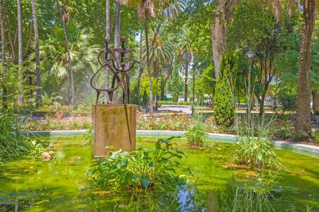 CORDOBA, SPAIN - MAY 28, 2015: The monern fountain Agricultor, Agricultura, y Progreso Jose Carrilero (1964) in Jardines de la Agricultura.