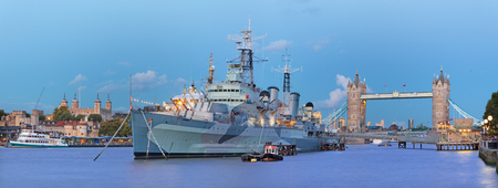 London - The panorama of the Tower bridge and cruiser Belfast at dusk. Editorial
