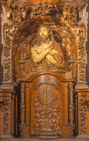 CORDOBA, SPAIN - MAY 29, 2015: The carved statue of flagellated Jesus Christ in scarleat coat in church Real Colegiata de San Hipolito by unknown artist.
