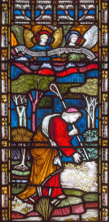 LONDON, GREAT BRITAIN - SEPTEMBER 19, 2017: The parable of of the Lost sheep on the stained glass in St Mary Abbots church on Kensington High Street.