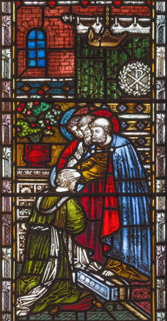 LONDON, GREAT BRITAIN - SEPTEMBER 19, 2017: The Sending of St. Paul on the stained glass in St Mary Abbots church on Kensington High Street.