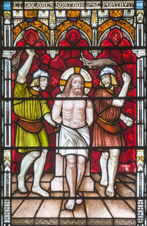 LONDON, GREAT BRITAIN - SEPTEMBER 19, 2017: The Flagellation on the stained glass in St Mary Abbots church on Kensington High Street.