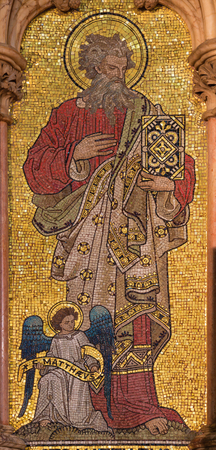 LONDON, GREAT BRITAIN - SEPTEMBER 19, 2017: The mosaic of St. Matthew the Evangelist in church St. Mary Abbots by Salviati from Venice (1882).
