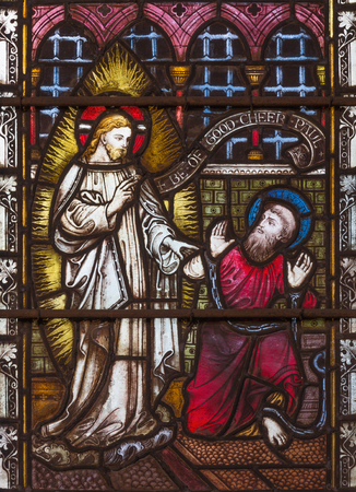 LONDON, GREAT BRITAIN - SEPTEMBER 19, 2017: The apparition of Jesus to St. Paul on Stained glass in St Mary Abbots church on Kensington High Street. Editorial