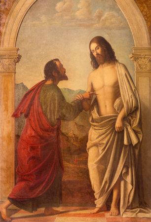 LONDON, GREAT BRITAIN - SEPTEMBER 18, 2017: The painting of Christ appearing to the doubting Thomas in church Immaculate Conception, Farm Street based on a original by Cima da Conegliano (1459 – 1517).
