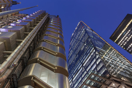 LONDON, GREAT BRITAIN - SEPTEMBER 18, 2017: The Leadenhall tower and Lloys building at dusk.