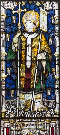 LONDON, GREAT BRITAIN - SEPTEMBER 17, 2017:  The St. Augustine of Canterbury on the stained glass  in church St. Barnabas by Martrin Travers 1945.