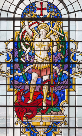 LONDON, GREAT BRITAIN - SEPTEMBER 14, 2017: St. Michael the archangel on the stained glass in church St. Lawrence Jewry by Christopher Webb (half of 20. cent.)